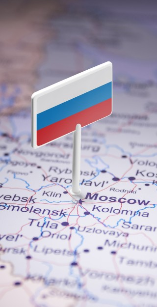 Map presenting Russian border and a Russian flag pointing of Moscow