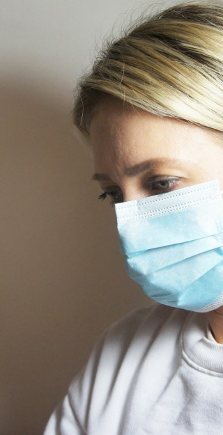 Woman with surgical face mask