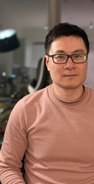 Man with glasses and dark hair looking at the camera.